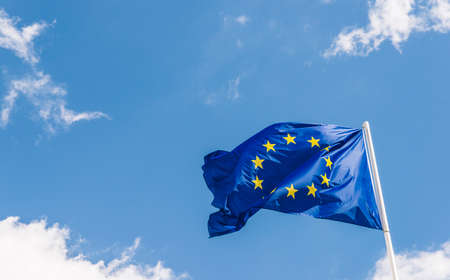 European Union EU flag against a blue sky. Soon there will be one less star since the UK voted to leave the EU in 2016 Stock Photo