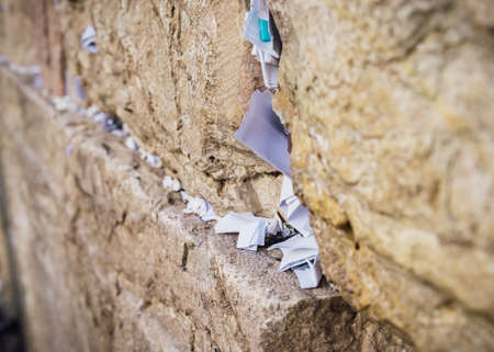 Selective focus on notes to God in the cracks between the bricks of the Western Wall, also known as Kotel, in the old city of Jerusalem, Israel. 版權商用圖片