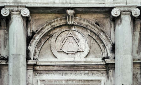 Eye of Providence, inside triangle interlaced with circle above doorway of building in Venice, Italy - It represents the eye of God watching over humanity, or divine providence