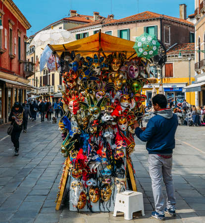 Market stalls in Venice selling Venetian masks among other souvenirs
