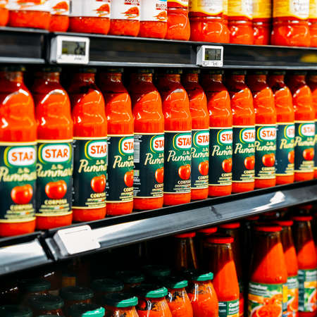 Illustrative editorial of a row of Star brand tomato sauce in a supermarket shelf