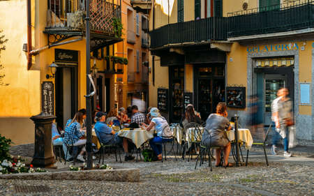 Tourists sitting at a cafe