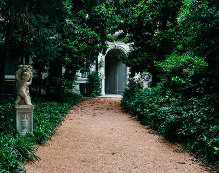 Entrance to Villa Invernizzi, in Porta Venenzia, Lombardy, Italy. This is a house of the founder of the famous Mio soft cheese .The garden features flamingos Publikacyjne