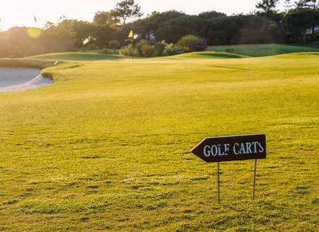 Empty golf course in Algarve, Portugal with signs for golf carts.