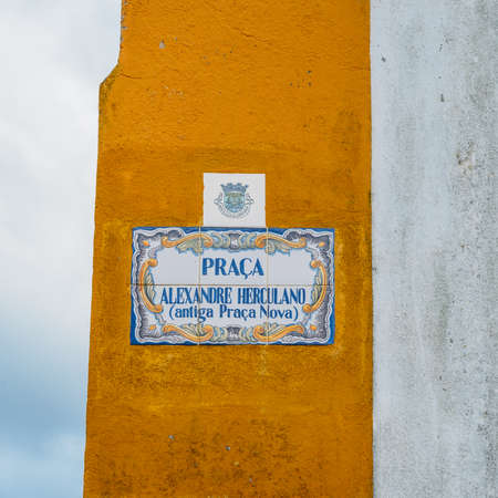 View of a street sign with traditional Portuguese azulejo tiles Editorial