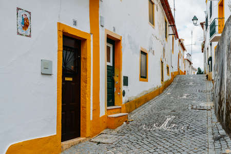 View of narrow paved street in Constancia, Portugal