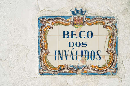 A traditional street sign in the historic centre of Cascais. Beco dos Invalidos means, alleyway of the handicapped