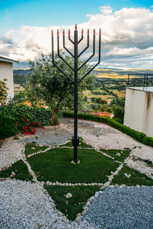 Iron Menorah overlooking the surrounding hills at Beit Eliyahu synagogue, Belmonte, Castelo Branco, Portugal Éditoriale