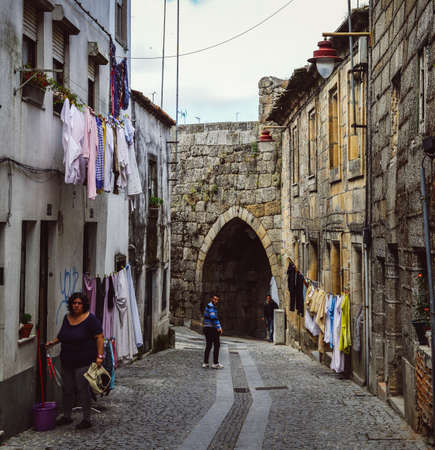Residents in Guarda, Portugals ancient Jewish district, the Judiaria, has retained much of its 14th century charm 写真素材 - 111315847