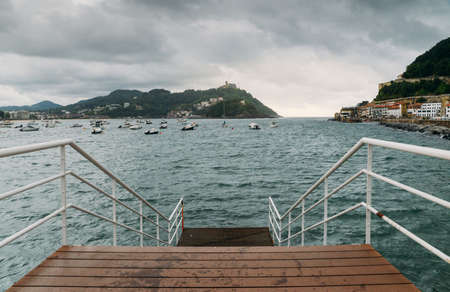 Famous beach of La Concha seen from the pier in Donostia San Sebastian, the coastal city on the Bay of Biscay