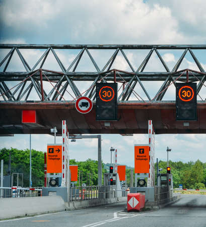 Cars passing through the point of toll highway, toll station in France, peage