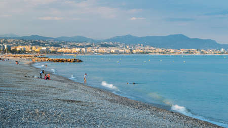 People on the most popular beach in Cagnes Sur Mer, France, Le Cigalon Plage Editorial