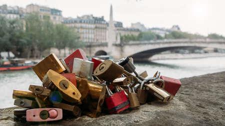 Love locks with Paris River Seine and bridge background, France Stok Fotoğraf