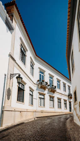 Detail of architecture of the streets of the city center with typical construction on a summer day - ultra wide angle. Captured in Faro, Algarve, Portugal