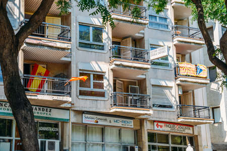 Spanish and Catalan flags on balconies Editorial
