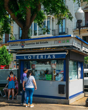 People line up to purchase lottery tickets on a stand on the Rambla Nova in the commercial centre of Tarragona, Spain. Spain has one of the most popular lotteries in the world
