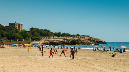 Vacationers in Arrabassada Beach, one of the famous golden sand beaches in the Spanish Costa Daurada Editorial