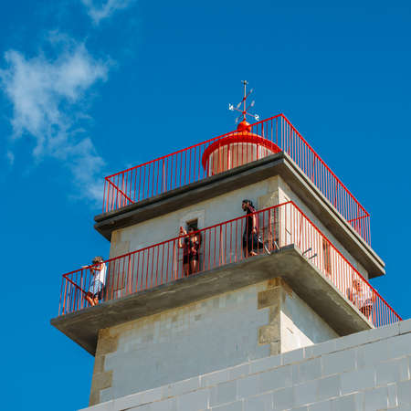 Tourists high up on the observation point at Santa Marta lighthouse in Cascais, Lisbon, Portugal