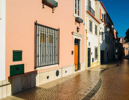 Cascais street scene with typical Portuguese architecture and cobblestones in the historic centre.