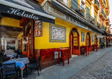 Facade of traditional colourful tapas bar in the historic centre of Seville