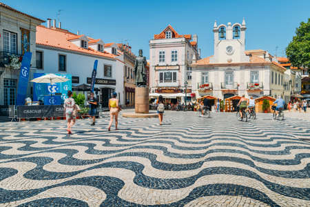 Tourists at Central Square - Praca 5 de Outubro - with beautiful pavement pattern and statue of Dom Pedro I