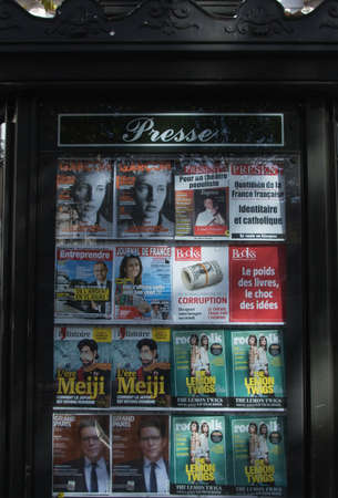 Kiosk with french printed press media at Place Monge in Paris