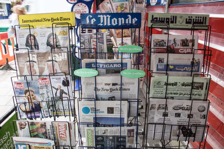 Newspaper stand with international newspapers and magaazines at a newstand in Central London Redakční