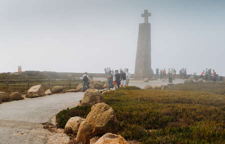 Tourists at a misty Cabo da Roca, a cape which forms the westernmost extent of continental Europe and the Eurasian land mass 에디토리얼