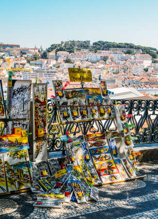 Watercolours for sale at a stall overlooking panoramic view over the center of Lisbon from the viewpoint called: Miradouro de Sao Pedro de Alcantara