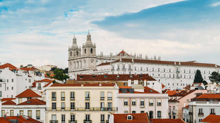 Panoramic view of Alfama district of Lisbon with Sao Vicente church in background, Portugal. Captured at Miradouro Porto do Sol