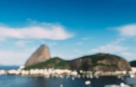 Deliberately defocused abstract view of Sugarloaf Mountain and Rio de Janeiro Brazil skyline reflecting on Botafogo Bay Stock Photo
