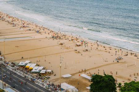 Aerial top view of People relaxing at Copacabana Beach in Rio de Janeiro, Brazil