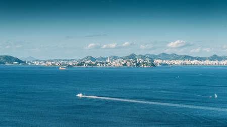 Sailboat on Guanabara Bay, Rio de Janeiro, Brazil with Niteroi city in background