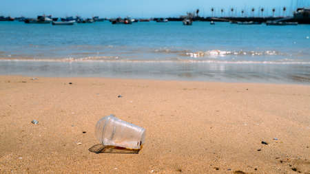 Rubbish Plastic cup left on the beach make pollution
