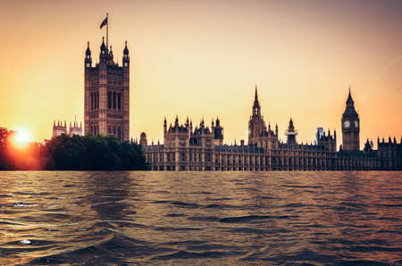 Digital manipulation of flooded Houses of parliament at sunset, London, UK