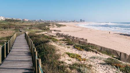 Wooden boardwalk at the Praia da Frente Azul, in english the blue beach front in the seaside resort Espinho
