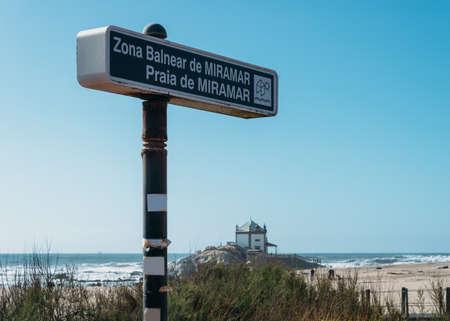 Sign to small church Senhor Da Pedra located in Portugal, in Miramar Beach Stock Photo
