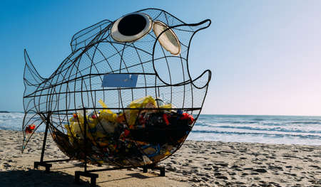 Giant fish shaped trash bin on a beach in Espinho, Portugal