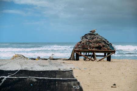 Beach with fishing net in Espinho near Porto, Portugal