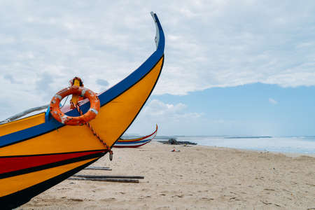 Typical colourful Moliceiro fishing boats on the beach in Espinho, Portugal