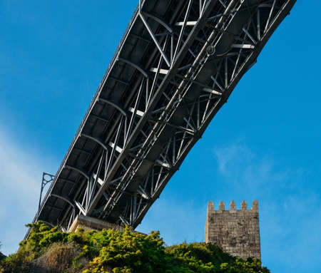 Medieval lookout tower at Muralha Fernandina Castle with Dom Luiz I Bridge in Porto, Portugal, Europe Stock Photo