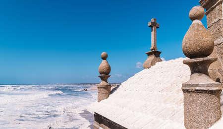 Senhor Da Pedra church in Miramar, Portugal perspective offering picturesque views next to the ocean Stock Photo