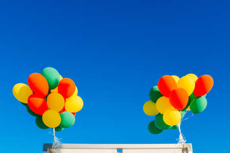 colorful balloons on a blue sky background Imagens