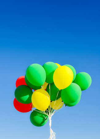 Colourful helium balloons against a blue sky Imagens
