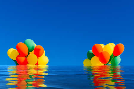 Flooded colorful balloons on a blue sky background with reflection on water Imagens
