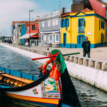 Traditional boats on the canal in Aveiro, Portugal. Colorful Moliceiro boat rides in Aveiro are popular with tourists to enjoy views of the charming canals.