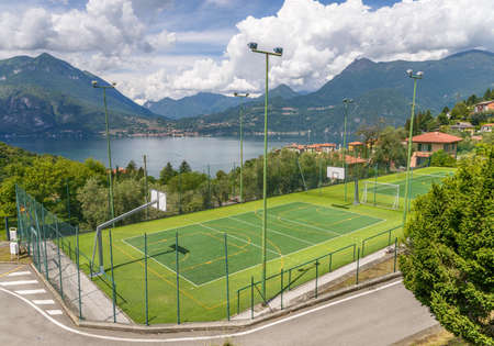 Soccer or football and basketball field on a background of mountains