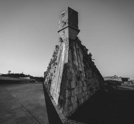 Wide angle corner of tower at Citadel of Cascais, Fortress in Cascais, Portugal in monochrome Banco de Imagens