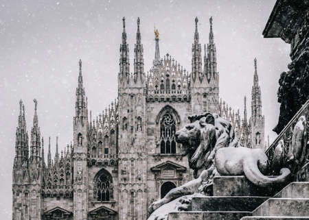 Snow falling at Piazza del Duomo in Milan, Lombardy, Italy with Milans landmark Cathedral in background