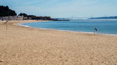 Giribita Beach near Lisbon, Portugal overlooking the iconic 25 April Bridge - Costa Verde Portuguese Riviera